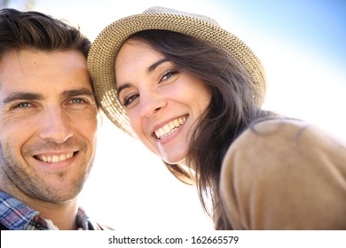 Portrait of cheerful 30-year-old couple