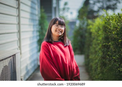 portrait of cheerful asian teenager standing outdoor