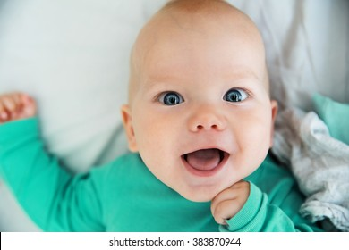 Portrait of a cheerful baby 6 months old