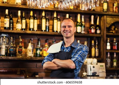 Portrait of cheerful barman worker standing