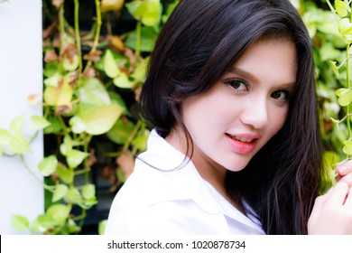 Portrait cheerful beautiful woman: Attractive woman has nice smile. Charming girl has beautiful face and nice skin. Gorgeous female has mixed race between English and Thai. Glamour lady feels happy.