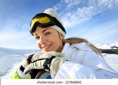 Portrait of cheerful blond woman at ski resort