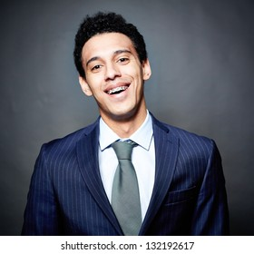 Portrait of a cheerful business guy with braces, against black background