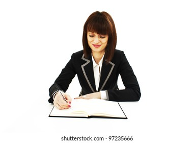 Portrait of a cheerful Business woman sitting on her desk holding a pen working with documents sign up contract.  Isolated over white background