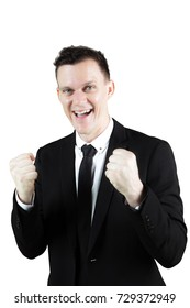 Portrait of a cheerful Caucasian businessperson expressing his success in the studio while wearing formal suit. Isolated on white background