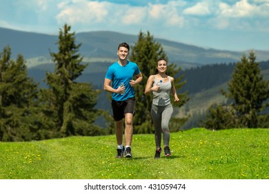 Portrait of cheerful Caucasian couple running outdoors.