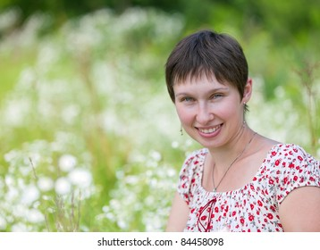 Portrait of a cheerful caucasian on chamomile background