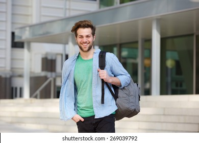 Portrait of a cheerful college student standing outside with back