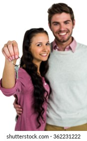 Portrait of cheerful couple holding keys on white screen