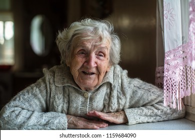 Portrait of cheerful elderly woman.