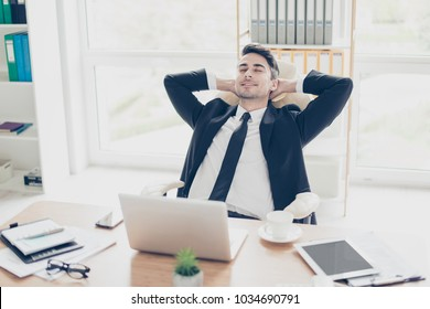 Portrait of cheerful excited glad careless carefree joyful leader successful expert professional relaxed employer enjoying his break at work having a daydream in front of laptop computer