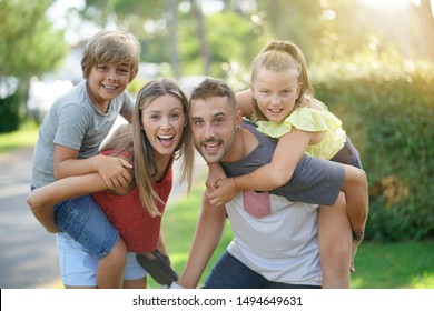 Portrait of cheerful family on summer vacation