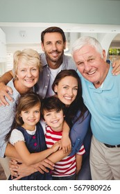 Portrait of cheerful family standing at home