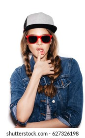 portrait of cheerful fashion hipster girl with braids going crazy in sunglasses, casual jeans clothes and cap, not isolated on white background