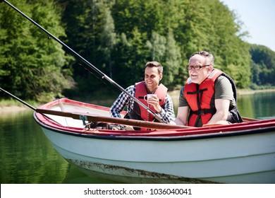 Portrait of cheerful fishermen in boat