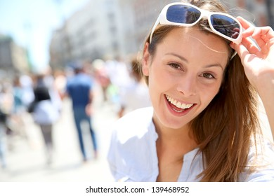 Portrait of cheerful girl with sunglasses