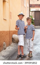 Portrait of cheerful and happy two brothers, outdoor, Italy.