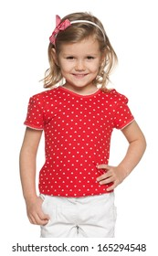 A portrait of a cheerful little girl in red shirt on the white background