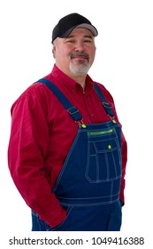 Portrait of cheerful man wearing dungarees standing against white background