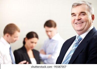 Portrait of a cheerful mature businessman smiling and looking at camera