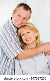 Portrait of cheerful mature man and woman smiling together