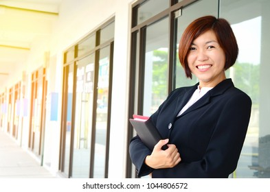 Portrait of a cheerful middle aged asian businesswoman