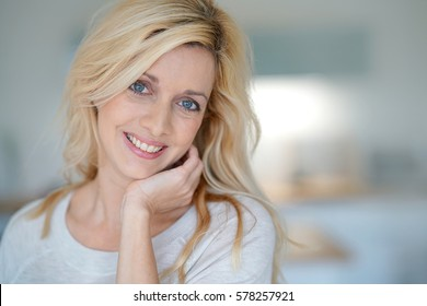 portrait of cheerful middle-aged blond woman