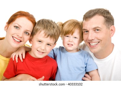 Portrait of cheerful parents with their two children on a white background