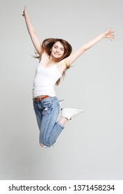 Portrait of cheerful positive girl jumping in the air