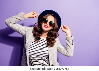Portrait of cheerful positive girl with red lipstick posing wearing overcoat striped outfit enjoying sunny day having weekend holiday isolated violet background