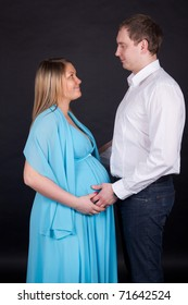 Portrait of a cheerful pregnant woman with her husband