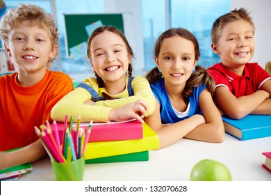 Portrait of cheerful school children flashing toothy smiles
