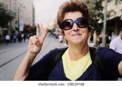 Portrait of cheerful senior woman enjoying the trip