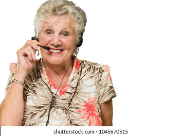 Portrait Of Cheerful Senior Woman With Telephone Headset On White Background