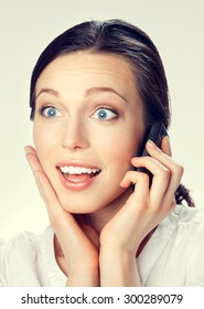 Portrait of cheerful smiling brunette businesswoman with cellphone