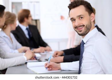 Portrait of cheerful smiling business man  at a meeting.