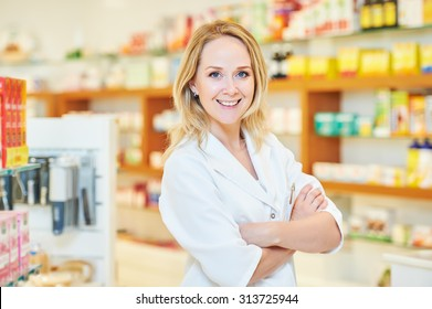 portrait of cheerful smiling female pharmacist chemist woman in pharmacy drugstore