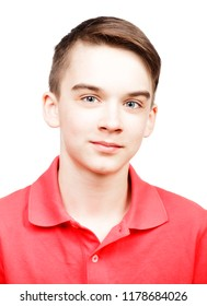 Portrait of cheerful teenager boy wearing red polo shirt isolated on white background