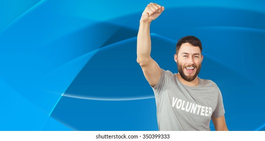 Portrait of cheerful volunteer against abstract blue design