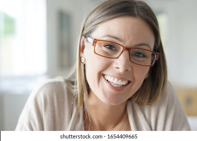 Portrait of cheerful woman with eyeglasses
