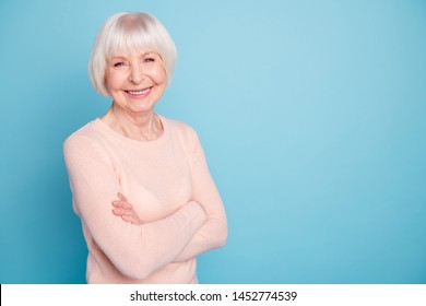 Portrait of cheerful woman looking at camera with her beaming smile isolated over blue background