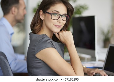 Portrait of cheerful woman at the office