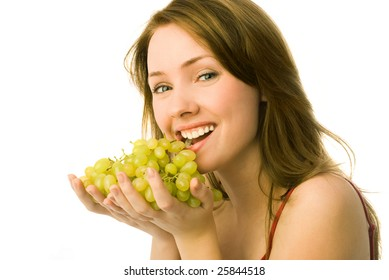 portrait of a cheerful young beautiful woman eating grapes