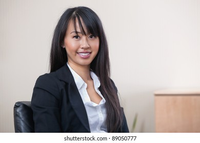 Portrait of a cheerful young businesswoman smiling