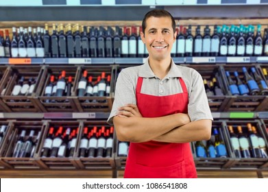 Portrait of cheerful young employee at a winery looking at camera smiling