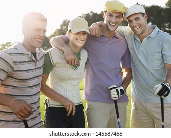 Portrait of cheerful young golfers on golf course