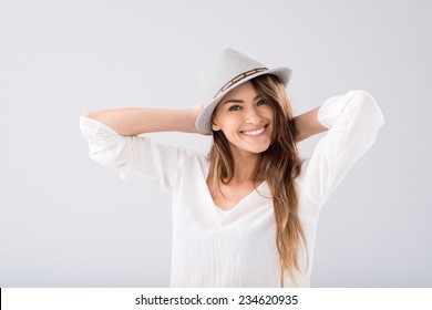 Portrait of cheerful young lady wearing a hat