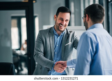 Portrait of cheerful young manager handshake with new employee.  - Shutterstock ID 1312231271