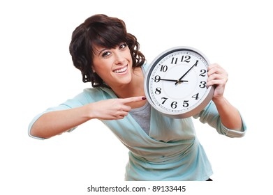 portrait of cheerful young woman with clock. isolated on white background