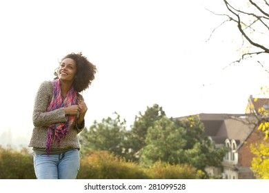 Portrait of a cheerful young woman laughing outside